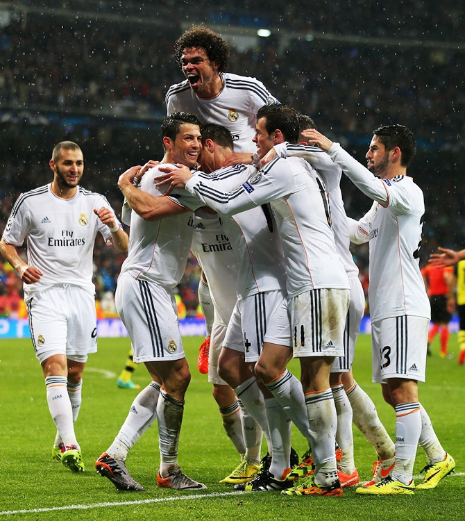 Cristiano Ronaldo of Real Madrid celebrates scoring his goal with teammates