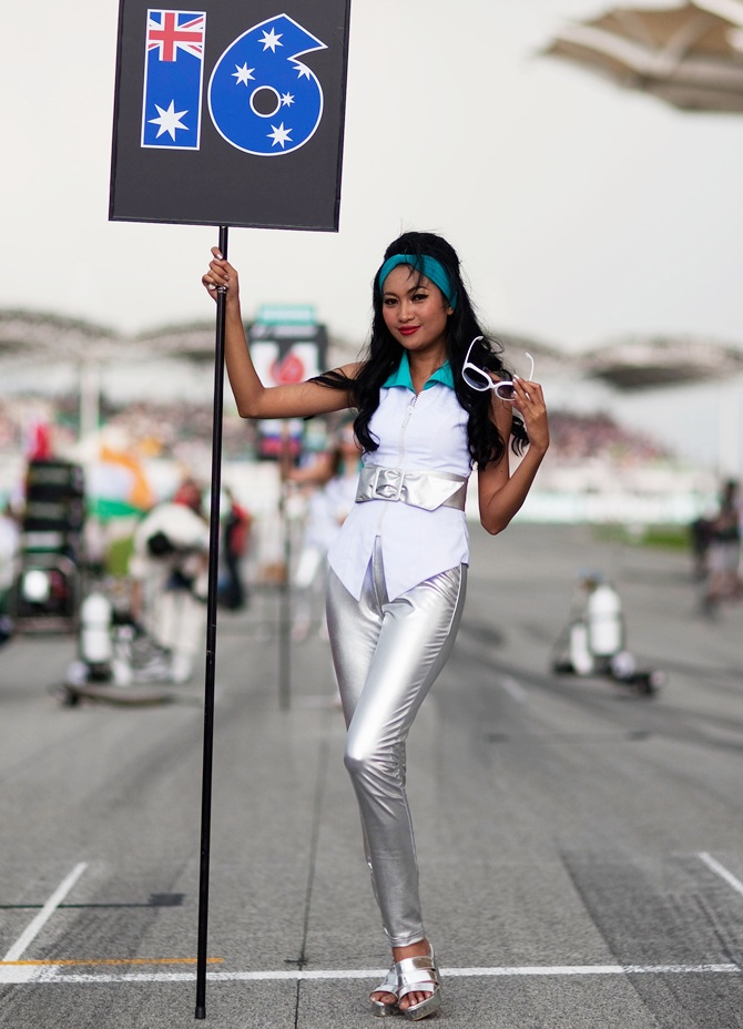 Grid girl for Daniel Ricciardo of Australia and Scuderia Toro Rosso is   seen before the Malaysian Formula One Grand Prix at the Sepang Circuit on March 25, 2012 in Kuala Lumpur