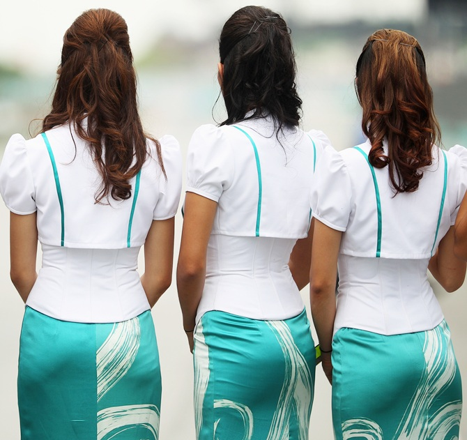 The grid girls before the start of the Malaysian Formula One Grand Prix at the Sepang Circuit on April 10, 2011 in Kuala Lumpur