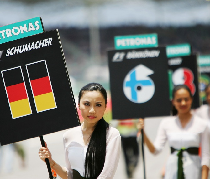 A grid girl holds the name of Ralf Schumacher of Germany and Toyota before the start of the Malaysian Formula One Grand Prix at the Sepang Circuit on April 8, 2007, in Kuala Lumpur