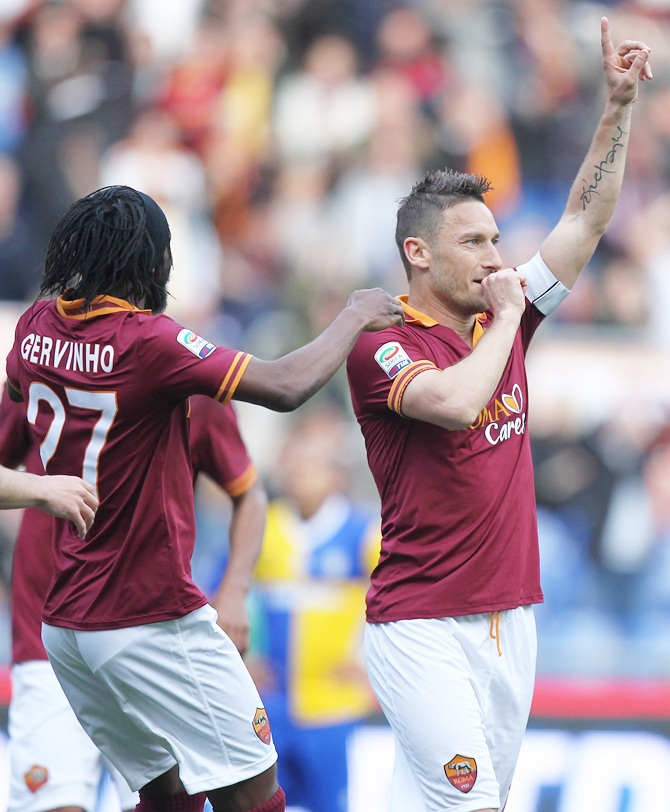 Francesco Totti of AS Roma celebrates after scoring the second team's goal during the Serie A match against FC Parma