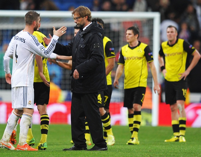 Sergio Ramos of Real Madrid shakes hands with Juergen Klopp, Coach of Borussia Dortmund