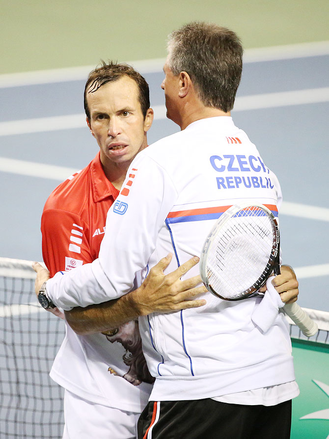 Radek Stepanek of Czech Republic hugs his coach after winning the match against Tatsuma Ito of Japan in their Davis Cup world group quarter-finals in Tokyo on Friday