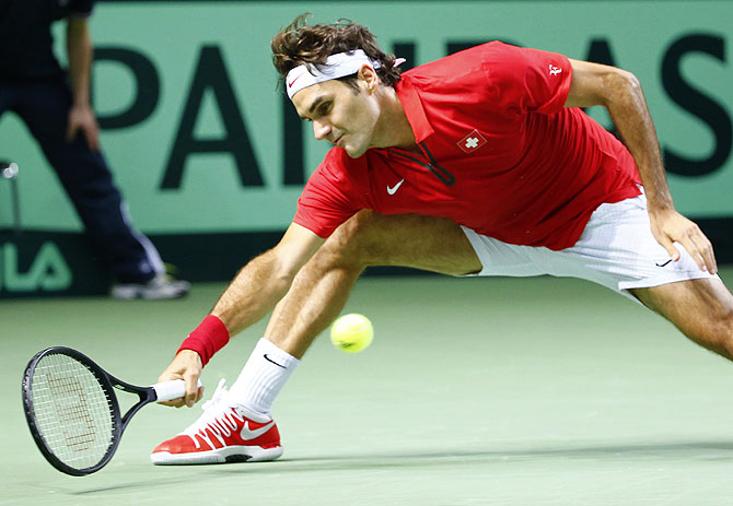 Switzerland's Roger Federer returns a ball during his Davis Cup quarter-final tennis match agains