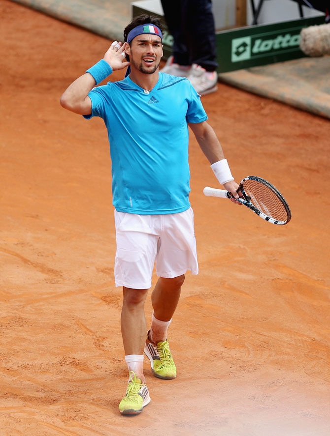 Fabio Fognini of Italy celebrates match point after his straight sets victory over Andy Murray of Great Britain during their Davis Cup World Group quarter-final at Tennis Club Napoli in Naples, Italy on Sunday