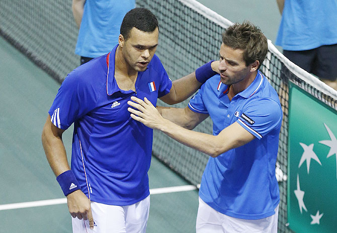 France's team captain Arnaud Clement (right) congratulates Jo-Wilfried Tsonga after his victory against Germany's Tobias Kamke during their Davis Cup quarter-final single tennis match in Nancy, on Sunday