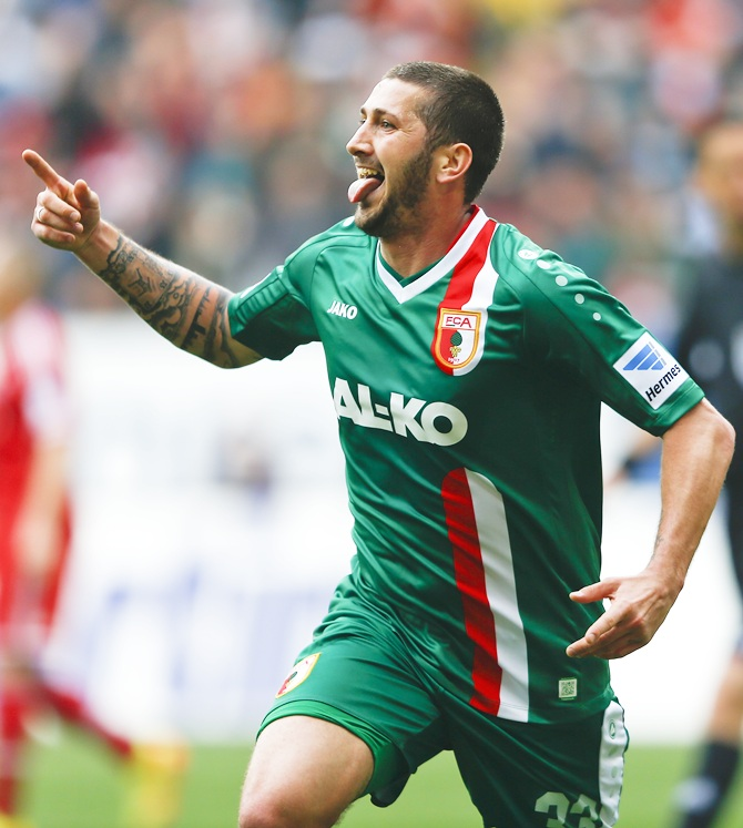 Augsburg's Sascha Moelders celebrates after he scored against Bayern Munich