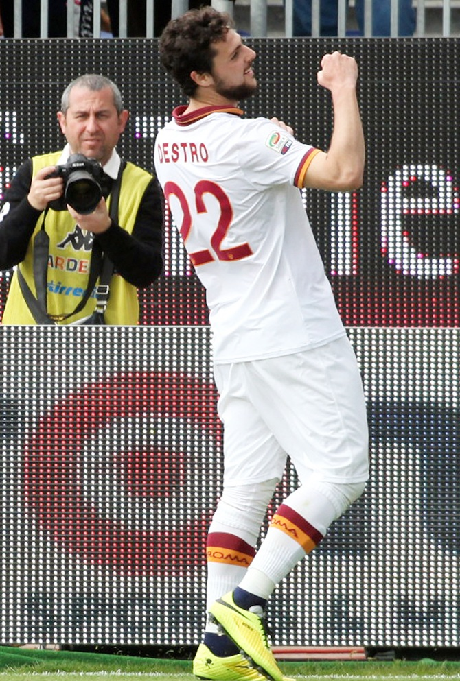 Mattia Destro,centre, of Roma celebrates after scoring their third goal and completing a hat-trick