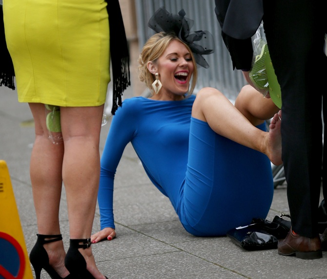 Racegoers swap their shoes for flip flops