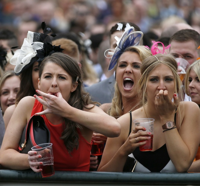 Racegoers enjoy the party atmosphere of Ladies Day