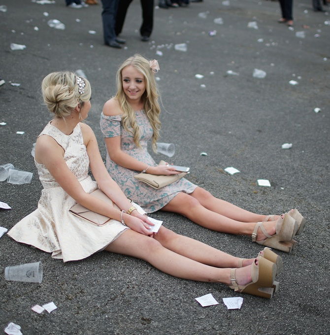 Racegoers relax as they enjoy the atmosphere of Ladies Day