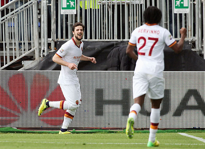 Mattia Destro (centre) of Roma celebrates with his teammates after completing a hat-trick against Cagliari Calcio at Stadio Sant'Elia in Cagliari, Italy on Sunday