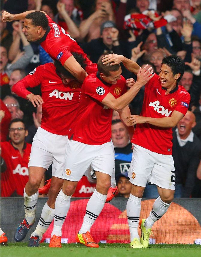 Nemanja Vidic of Manchester United celebrates with Shinji Kagawa of Manchester United