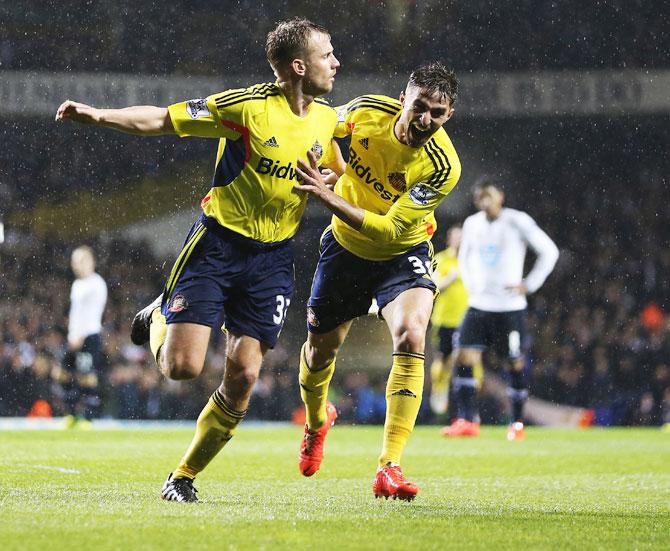 Lee Cattermole (left) of Sunderland celebrates with teammate with Fabio Borini after scoring the opening goal against Tottenham Hotspur on Monday