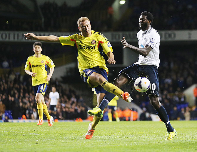 Emmanuel Adebayor of Tottenham Hotspur challenges Wes Brown of Sunderland on Monday