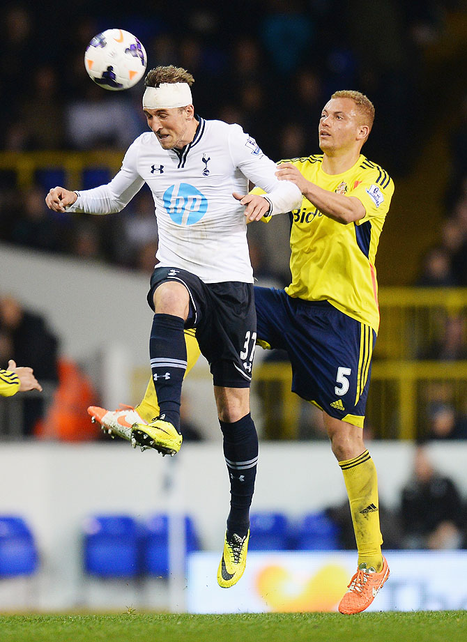 Harry Kane of Tottenham Hotspur wins a header against Wes Brown of Sunderland on Monday