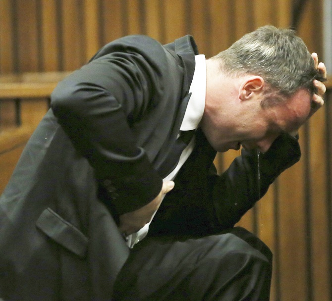 Oscar Pistorius becomes emotional during his trial at the high court in Pretoria