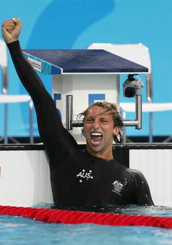 Ian Thorpe celebrates after winning the men's swimming 200 metre freestyle final on August 16, 2004 during the Athens 2004 Summer Olympic Games at the Main Pool of the Olympic Sports Complex Aquatic Centre