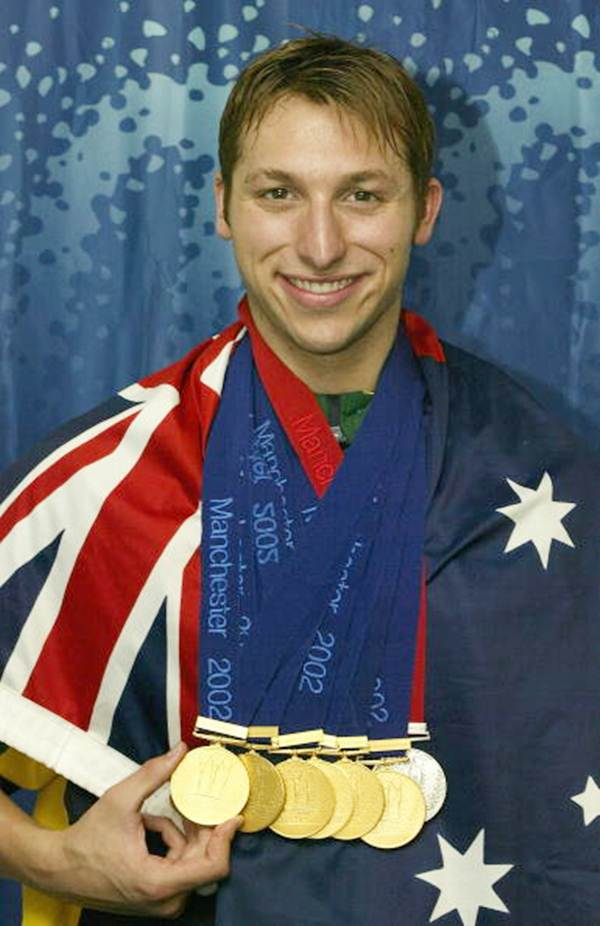 Ian Thorpe poses with the six gold medals and one silver medal he won during the 2002 Commonwealth Games, Manchester, England on August 5, 2002.