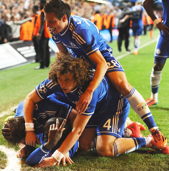 Demba Ba of Chelsea celebrates scoring their second goal with teammates