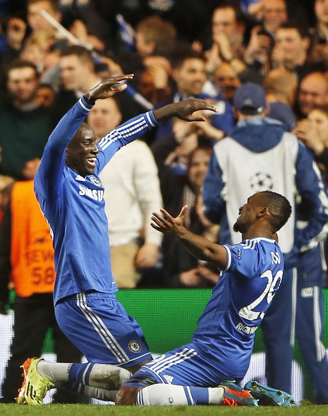 Chelsea's Demba Ba,left, who scored the second goal for the team, celebrates with team mate Samuel Eto'o