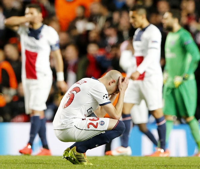 Paris St Germain's Christophe Jallet and teammates react after being defeated by Chelsea