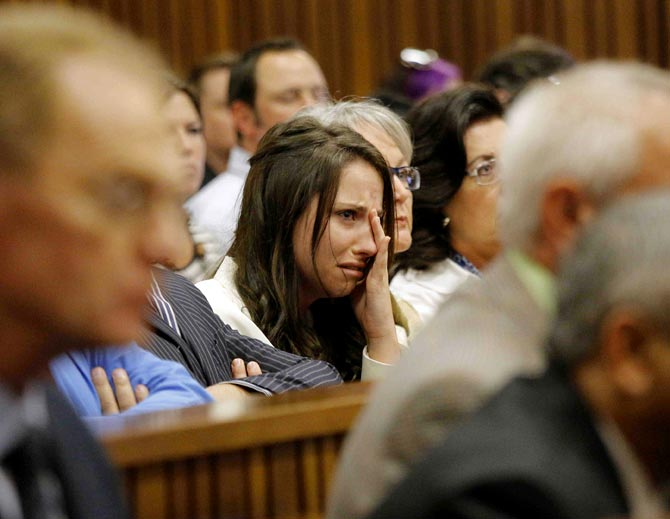 Aimee Pistorius, sister of South African Olympic and Paralympic sprinter Oscar Pistorius cries as he gives evidence during his trial at the high court in Pretoria