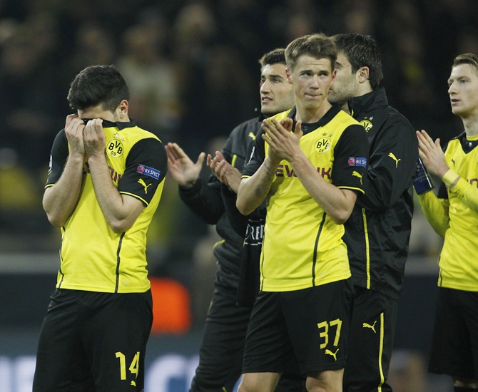 Borussia Dortmund's players react after their Champions League   quarter-final second leg soccer match against Real Madrid in Dortmund
