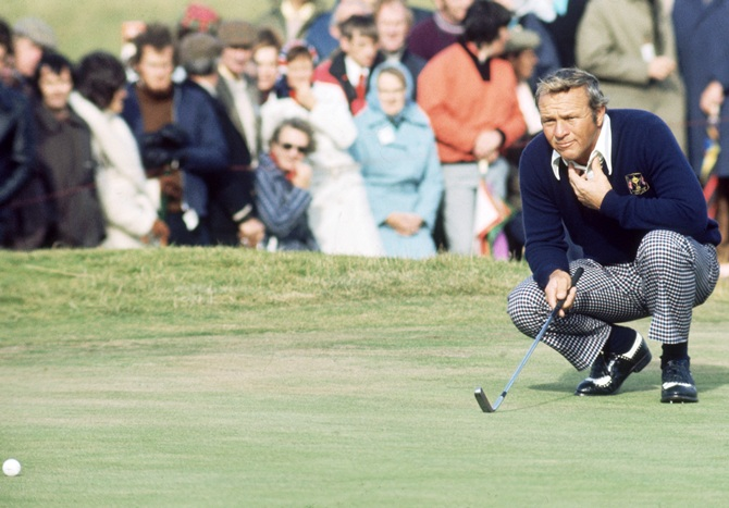 Arnold Palmer of the USA lines up a putt