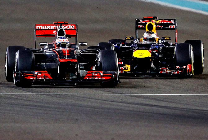 Red Bull's Sebastian Vettel (right) tries to overtake Jenson Button of McLaren