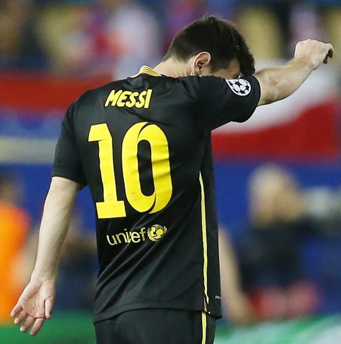 Barcelona's Lionel Messi reacts during his team's match against Atletico Madr