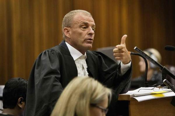 State prosecutor Gerrie Nel gestures as he cross examines Oscar Pistorius