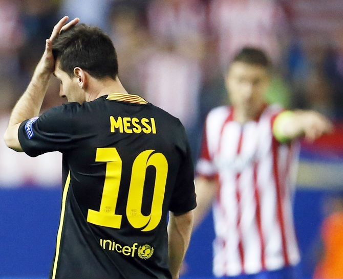 Barcelona's Lionel Messi reacts