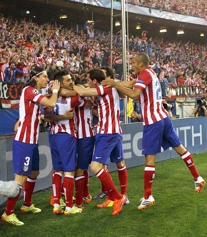 Atletico Madrid players celebrate a goal