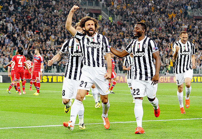 Andrea Pirlo of Juventus #21 celebrates scoring against Olympique Lyon at Juventus Arena on Thursday