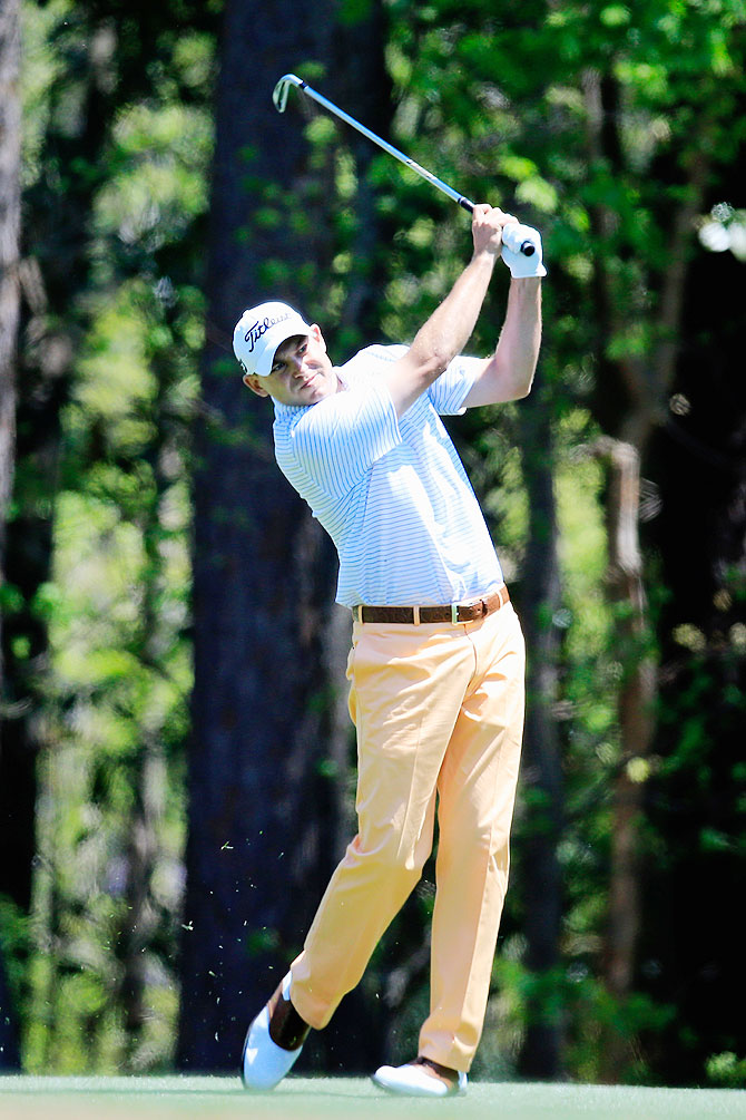 Bill Haas of the United States watches his approach shot on the 11th hole during the first round of the 2014 Masters Tournament at Augusta National Golf Club on Thursday