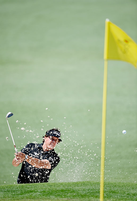 Phil Mickelson of the United States plays a bunker shot on the second hole during the first round of the 2014 Masters Tournament at Augusta National Golf Club on Thursday