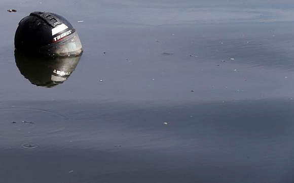 A helmet is seen at the Guanabara Bay in Rio de Janeiro