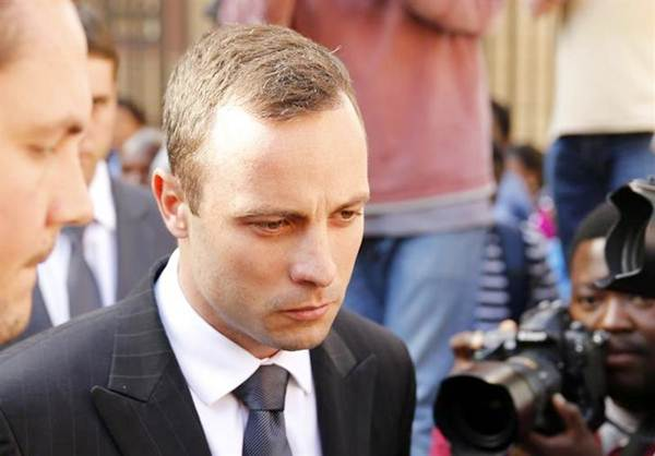 Olympic and Paralympic track star Oscar Pistorius reacts after the day's proceedings at the North Gauteng high court in Pretoria