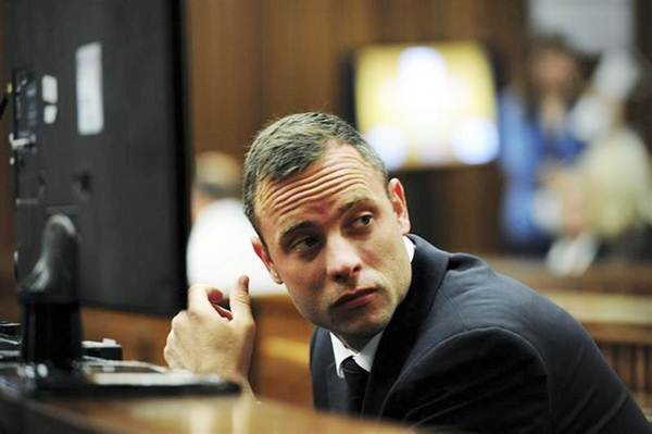 Oscar Pistorius sits in the dock during court proceedings