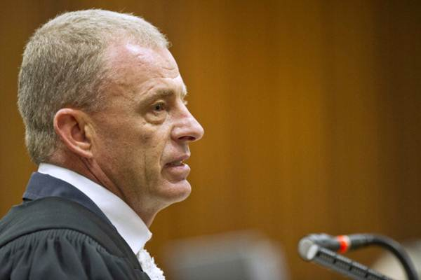State prosecutor Gerrie Nel questions Oscar during cross examination in the Pretoria high court