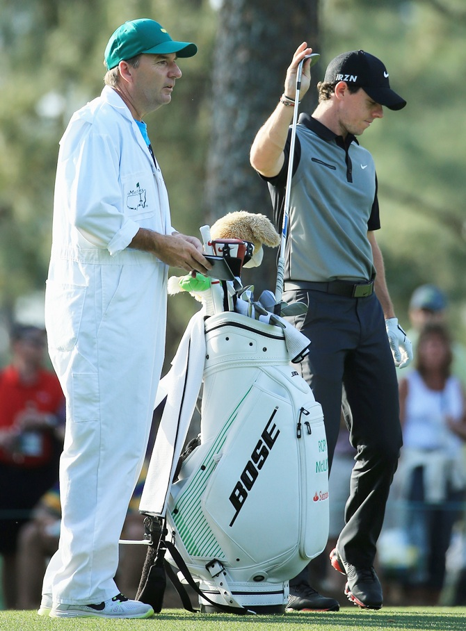 Rory McIlroy of Northern Ireland get a club from his caddie JP Fitzgerald