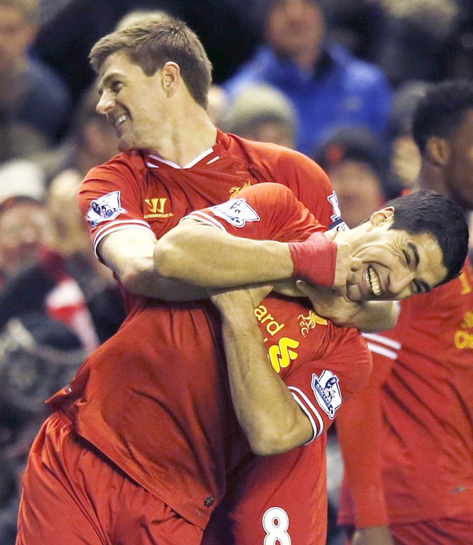 Liverpool's Steven Gerrard,left, celebrates with teammate Luis Suarez