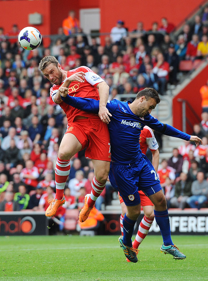 Rickie Lambert of Southampton rises above Juan Cala of Cardiff to direct a header on goal at St Mary's Stadium in Southampton on Sunday