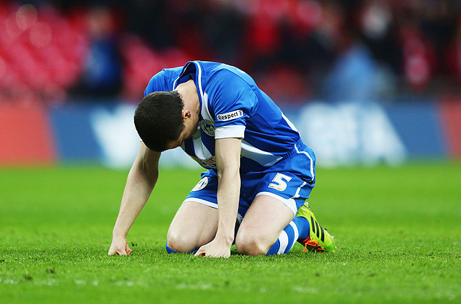 Gary Caldwell of Wigan Athletic reacts after missing a penalty in the shootout on Saturday