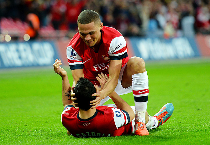 Arsenal Kieran Gibbs congratulates teammate Santi Cazorla on scoring the winning penalty on Saturday