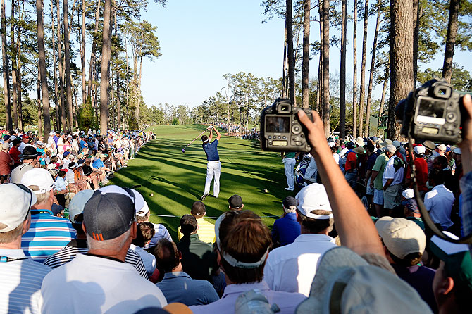 Fans capture pictures as Bubba Watson of the United States hits his tee shot on the 17th hole on Saturday