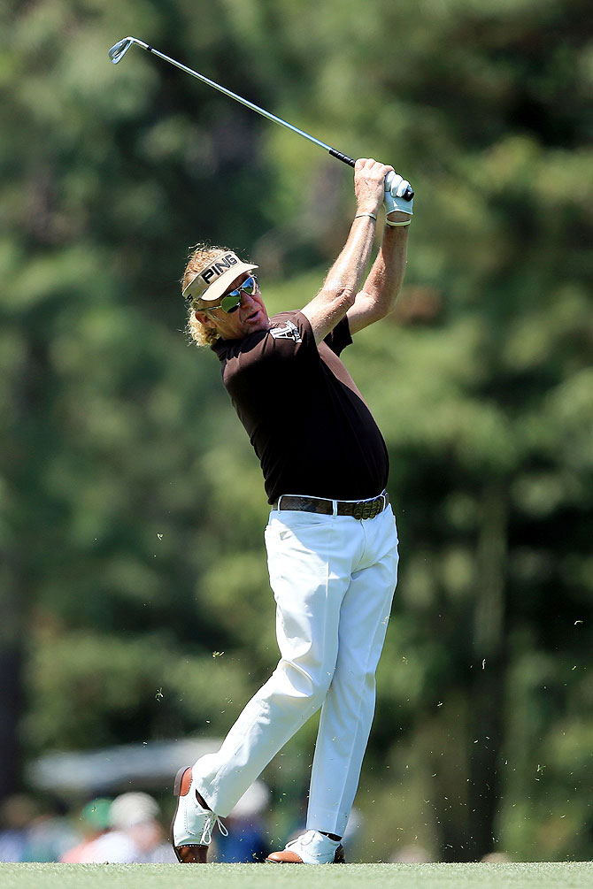 Miguel Angel Jimenez of Spain watches his approach shot on the 14th fairway on Saturday