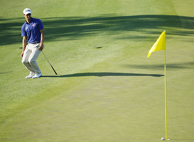 Australia's Adam Scott misses a chip on the 15th hole on Saturday