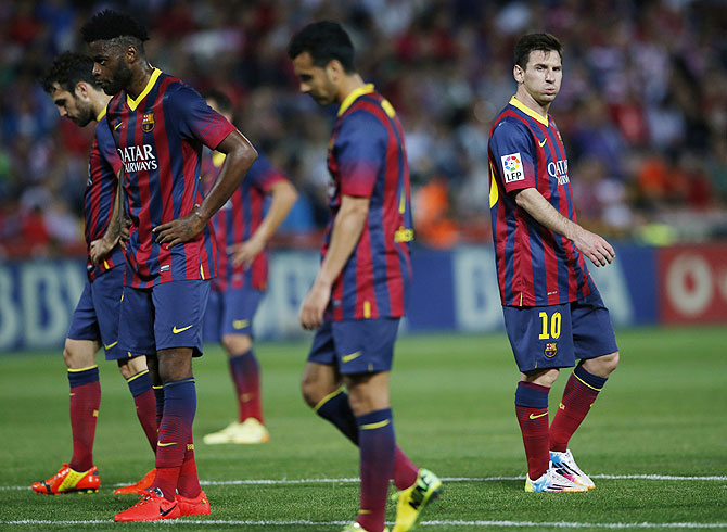 Barcelona's players wear a dejected look during their La Liga match against Granada at Nuevo Los Carmenes stadium in Granada on Saturday